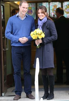 Smiling: Kate, 30, left the hospital with her husband Prince William as the furore over the hoax call that duped a nurse into revealing details about the Duchess's health continues
