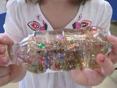 glitter jars from irresistible ideas for play based learning (Glitter Bottle) Christmas Activities For Kids, Craft Activities For Kids, Preschool Crafts, Kids Christmas, Crafts For Kids, Science Center Preschool, Calming Jar, Discovery Bottles, Glitter Jars