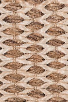 Honeycomb handwoven abaca rug, by Merida.