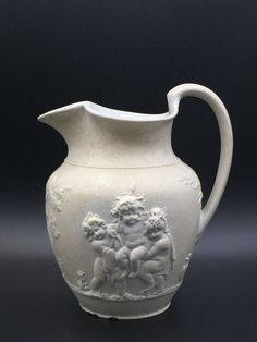 Wedgwood Rosso antico jug ca. 1820.  The Cupid scenes are copied from engravings by Bartolozzi.