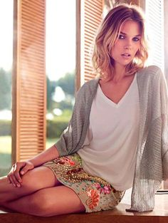 Patterned mini skirt with grey sweater