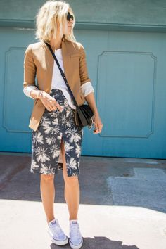 beige blazer and palm patterned skirt