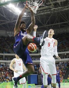 United States' DeAndre Jordan (6) scores over China's Zhai Xiaochuan (9) during a men's basketball game at the 2016 Summer Olympics in Rio de Janeiro, Brazil, Saturday, Aug. 6, 2016. (AP Photo/Eric Gay)