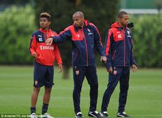 Thierry Henry (centre) gives instructions to Arsenal Under 19s winger Riess Nelson (left) in training