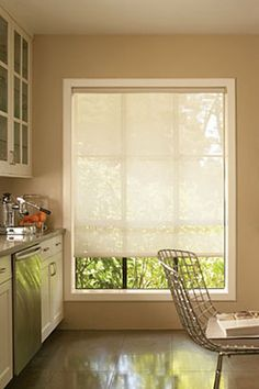 Solar Shades are the unofficial shades of summer. With varying degrees of opacity, these shades let you enjoy your view of the outdoors while blocking glare and harmful UV rays. Featured: Solar Roller Shades in White/Linen Large Window Coverings, Valance Window Treatments, House Blinds, Blinds For Windows, Sash Windows, Arched Windows, Bedroom Window Dressing, Solar Shades, Bedroom Windows