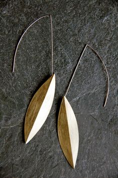 Contemporary jeweler, metalsmith and creator of photographic imagery.