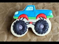 I made Monster Truck Cookies. These are really fun to make and I hope you enjoy the step by step video tutorial I made. I love to bake, decorate cookies, cak. Monster Jam, Monster Truck Cookies, Car Cookies, Onesie Cookies, Monster Truck Birthday, Cookies For Kids, Royal Icing Cookies, Cookies Et Biscuits, Monster Trucks