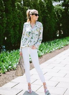 Update a classic style with a fun floral print. Emily of The Ivory Lane rocks a pastel rose-printed top with white skinnies and a pair of lace-up sandals to enjoy the warming spring weather.