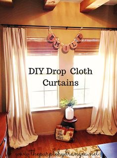 Drop cloths are the answer to your home decor budget woes. Try these easy no sew drop cloth curtains.