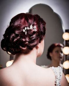 Vintage Bridal Hair & Make Up Tips {1920s to1950s} | Confetti Daydreams - 1920's-30's Rolled up ponytail updo