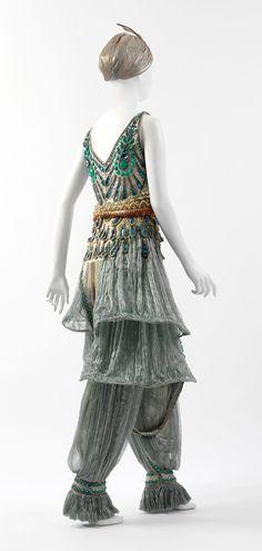 Fancy dress costume Designer: Paul Poiret (French, Paris 1879–1944 Paris) Date: 1911 Culture: French Medium: metal, silk, cotton Credit Line: Purchase, Irene Lewisohn Trust Gift, 1983