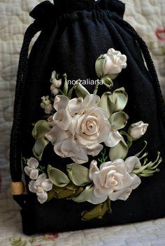 Pretty ribbonwork flowers on pouch.
