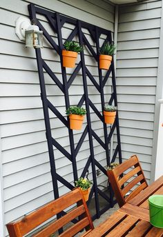 Verticle Garden with a homemade chevron trellis. Perfect for a small patio or any Outdoor space! I picked succulents since they are simple and easy to take care of .