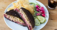 Original Reuben Sandwich - The real-deal original begins with well-buttered rye and is heavy on the corned beef and sauerkraut. Reuben Sandwich, Sandwich Board, Sandwich Spread, Alton Brown, Steak Sandwich Recipes, Sandwich Ideas, American Sandwich Recipes, Vegetarian Sandwiches, Chicken Sandwich