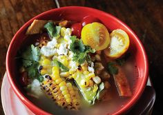 from bon appetit TORTILLA SOUP A colorful array of garnishes offer a fresh contrast to this bold, smoky chicken soup from Nashville's Mas Tacos Por Favor. Korma, Biryani, Corn Recipes, Mexican Food Recipes, Quesadillas, Tortillas, Dutch Oven Recipes, Cooking Recipes, Healthy Recipes