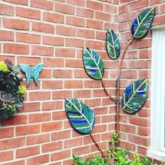 #mosaic leaf #trellis installed- hopefully this new clematis vine will cover the copper trellis by next year. #mosaico #gardenart #clematis #glass #smalti #artstudio