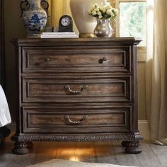 Features:  -Material: Hardwood solids and pecan veneers.  -Three drawers.  -Receptacle.  -Cedar in bottom drawer.  -Rhapsody collection.  Frame Material: -Wood.  Product Type: -Standard dresser (horiz