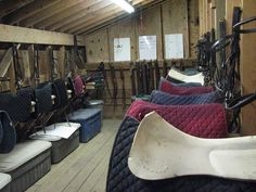 Tack room set-up. Four feet of wall and floor per boarder for trunk, saddle and bridle. Have divider mesh walls between each section for extra hanging space. Also have a blanket hanging wall.