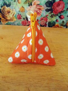 Check out this item in my Etsy shop https://www.etsy.com/uk/listing/269704111/floral-coin-purse-pyramid-coin-purse