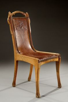 EUGENE GAILLARD | Rare Art Nouveau carved walnut chair with a leather seat hand tooled with an iris flower. Circa 1900.