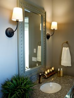 HGTV Dream Home 2012 | Location: Provo, Utah | Guest Bathroom | The vanity mirror, handcrafted by David Brown, is trimmed in a gray frame that blends seamlessly into the walls, creating the illusion of more space.
