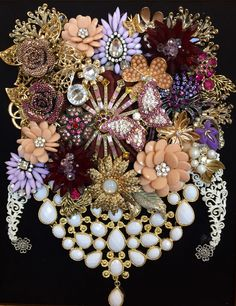 Recycled jewelry art flowers by Leslee Martin