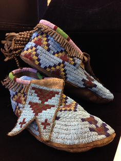 Sioux Beaded Buffalo Hide Moccasins, ca 1900. NEVER JUDGE A INDIAN  UNTIL YOU HAVE WALK A MILE IN HIS MOCCASINS