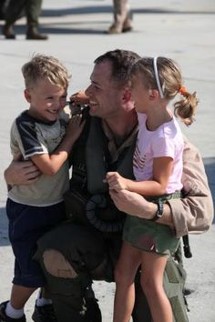 Capt. Trevor J. Felter, an AV-8B Harrier pilot with Marine Attack Squadron 223, hugs his son and daughter, Aug. 10, after returning from a seven-month deployment with the 24th Marine Expeditionary Unit.    Read more: http://www.dvidshub.net/image/310869/marine-corps-times-leatherneck-magazine-marines-magazine#.T2AYCMVmLbM#ixzz1p3o891sU