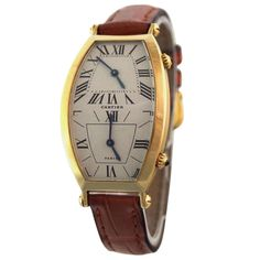 Cartier Yellow Gold Dual Time Tonneau Wristwatch | From a unique collection of vintage wrist watches at http://www.1stdibs.com/jewelry/watches/wrist-watches/