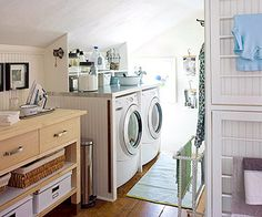 lovin this laundry room, drying racks on walls, clotheslline over table, alot in a small space