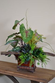 This caladium arrangement brings the outside in with help from Trees n Trends