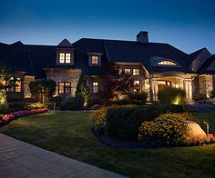 Show off an eye-catching facade at all hours of the day with mixed layers of outdoor lights. See our secrets to outdoor lighting: http://www.bhg.com/home-improvement/lighting/outdoor/fabulous-outdoor-lighting/?socsrc=bhgpin052713outdoorlighting