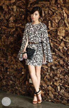 Cape dress and classic heels