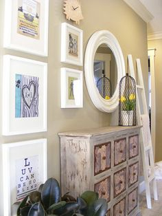 a great gallery wall: combing: photos, ladder, mirror, clock, etc - hallway leading downstairs?