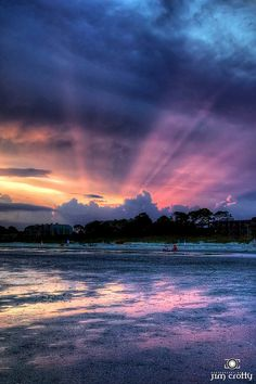 Streaming light at sunset behind storm clouds, over beach on Hilton Head Island, SC (by Jim Crotty)