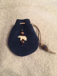 Polar bear bead carved from bone, blue leather medicine bag
