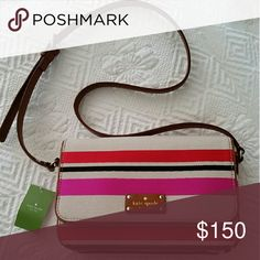 🌹KATE SPADE 🌹 Oak Island Stripe  Cross body bag Kate Spade  Fynn Oak Island Stripe Crossbody Bag. 100%authentic.  Long strap for shoulder or crossbody wear. Features 1 slip pocket and 1 zip enclosed pocket in addition to the main compartment. Magnetic front Closure. Brown leather trim kate spade Bags Crossbody Bags