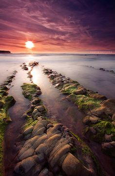 Sunset over rocks and water