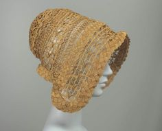 A beautifully worked French straw bonnet from 1848. Openwork bonnets were popular for summer in the mid-19th century, presumably as they actually allowed some sort of airflow to take place.