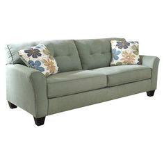 Featuring rounded track arms, tapered block legs, and cool lagoon upholstery, this sofa accents your den or living room in airy appeal.