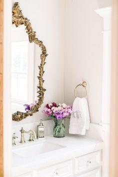 Powder bath remodel white quartz and antique gold mirror Gold Mirror Bathroom, Antique Gold Mirror, Gold Mirrors, Half Bath Decor, Half Bath Remodel, Gold Faucet, Stock Flower, White Quartz, Flower Arrangements