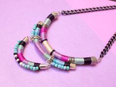 Multilayer necklace featuring a small bib on bottom give this unique appearance with  multicolor matching plastic beads to give this unique tribal