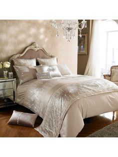 Kylie Minogue Jessa Duvet Cover in Double, King and Super King sizes Bring a glitzy new look to your bedroom with this gorgeous duvet cover from the glamorous Jessa bedding range by petite pop princess Kylie Minogue. Against a sophisticated blush satin canvas, it flaunts an exquisite panel of sparkling gold and silver sequin clusters for a dazzling effect. The reverse is crafted from sumptuously soft 100% cotton, giving it a lavish feel that makes it incredibly cosy to snuggle up under…