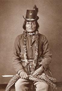 """Akicita Hanska, """"Long Soldier,"""" Hunkpapa Chief of the Standing Rock Agency wears a beaver top hat in vogue during the Civil War. He signed the Treaty of Fort Laramie in 1868.  By Orlando S. Goff."""