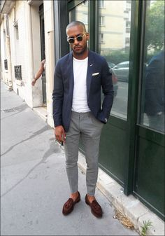 Blue jacket, white T-shirt, grey trousers, brown loafers