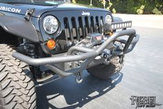 Black Rhino - Rubicon with Attitude: Close up view of the custom Rugged Ridge prerunner front bumper.