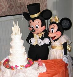 Mickey & Minnie taking a good look at the Cinderella Castle wedding cake