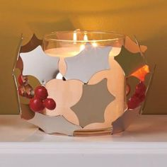 """Holly leaves are crafted from highly polished metal for a merry mirrored shine. Display with an Escential or GloLite jar or pillar candle, sold separately, for the perfect holiday centerpiece. 4½""""h 7""""dia. $25.00"""