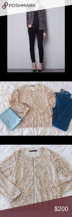"""NWOT ZARA sequins Embellished bomber jacket NWOT ZARA sequins embellished bomber jacket. Brand new, excellent condition. Super lovely and fashionable item for Spring😍🌸The one I have is ivory peach color, the main photo is just to show how it fits. 100% handmade, so there might be some imperfections. Beautiful multi color sequins and spangles are stitched. Fully lined inside. Elastic bands to make it comfy. Total length: 23"""", width: 18"""", sleeve: 24. Feel free to ask any questions if you…"""