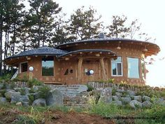 """Korean cordwood and cob (cobwood) traditional """"Korean soil house."""" It has a circular roof and a timbered entryway. The roof consists of slate tile. http://blog.daum.net/ For information on how to prepare a cob mortar with cordwood www.cordwoodconstruction.org"""
